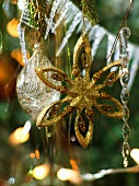 Glittery, gold star Christmas tree decoration