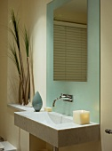 Modern bathroom in pastel tones - designer basin decorated with candles and grasses