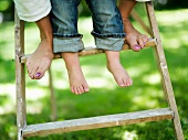 Feet on a wooden ladder
