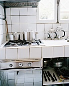 White-tiled kitchen corner with gas hob