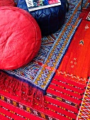 Colourful rugs and floor cushions