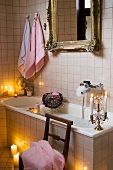 Vintage-look bathroom in candlelit atmosphere