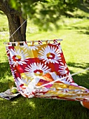 Colorful hammock with white floral pattern in the garden