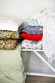 Assorted pillows and bedspreads