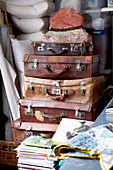 Stack of vintage suitcases in utility room