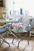 Breakfast table with English garden chairs, gingham cushions and romantic vintage-style accessories