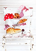 Fresh croissants decorated with cheerful decorative toadstools