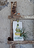 Hand-made Christmas card on wooden ladder