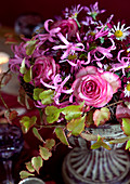 Autumnal bouquet of roses in amphora