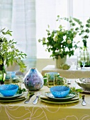 Colored place settings on a table with a tablecloth