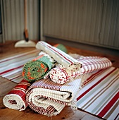 Carpet runners (rolled and spread out) in folkloric style