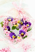 Heart-shaped flower wreath of violas and hyacinth florets