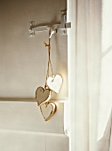 String with heart-shaped, wooden tags hanging on door handle
