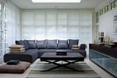 Grey corner sofa with matching cushions and coffee table with leather-covered top
