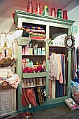 Shabby chic shop - painted wardrobes without doors displaying goods for sale