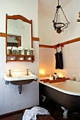 Vintage bath with free standing bath tub and candle light