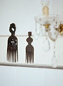 Ethnic-style decorated wooden combs hung on wall