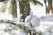 Silver bauble on tree