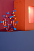 Wire sculpture next to light box