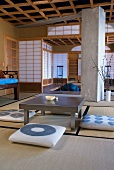 Japanese tea room with floor cushions around low table