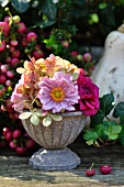 Autumn arrangement of dahlias, asters, hydrangeas, pumpkin, ivy and berries