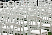 White chairs on lawn