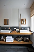 Handcrafted ornaments and grey slate combined with solid beech wood washstand with countertop basins