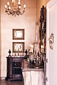 Half-height cabinet against stone wall in grand room