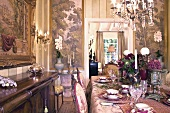 Festive set table in grandiose setting of Baroque dining room