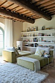 Duo of designer chaise longues with flokati rug in renovated country house