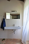 Minimalist bathroom with designer sink and mirror