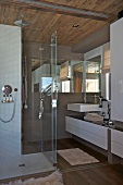 Designer bathroom with shower area in rustic wooden hut