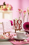 A cup of coffee on a lovingly decorated table for Valentine's Day
