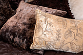 Brown and cream velvet cushions