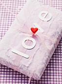 A grift-wrapped parcel with the word 'love'