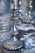 Silver candlesticks on festive table