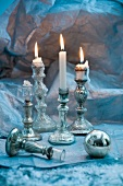 Antique silver candlesticks and Christmas bauble