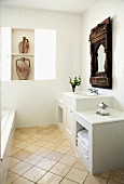 Light and bright bathroom with a white vanity and antique, Indian wall mirror