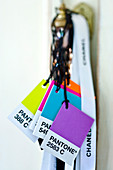 Colour cards hung from cords