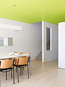 Dining room with white walls and green suspended ceilings