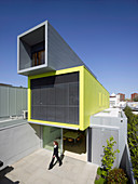Architect-designed house constructed of three stacked, container-shaped elements