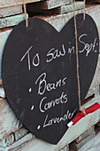 Vegetable and herb notes - writing on heart-shaped blackboard