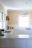 U shaped kitchen units in a simple kitchen