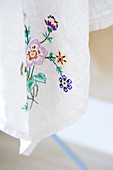 Floral embroidery on a white table cloth