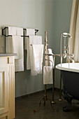 Bathroom with antique bathtub, silver, floor-mounted tap fittings and towel rail