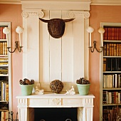 Unusual wicker bull's head on chimney breast of classic French fireplace