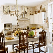 Lunch in Scandinavian kitchen with antique wooden chairs around dining table