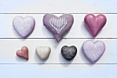 Purple hearts made of different materials
