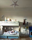 Children in bunk beds in rustic children's bedroom