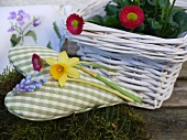 Spring decoration: fabric heart and basket of spring flowers